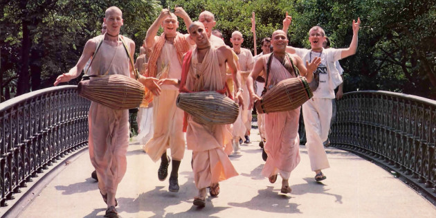 Hare Krishna Brahmacaris Chanting Crossing a Bridge in a Park